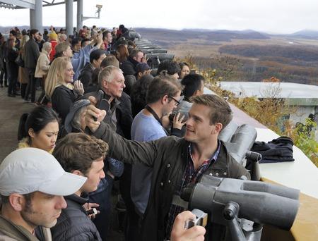 dora: Imjingak, South Korea-November 14, 2015; DMZ Zone (South Korea): tourists watching North Korea with binoculars from the South Korean base of Dora Observatory. November 14, 2015 Imjingak, South Korea