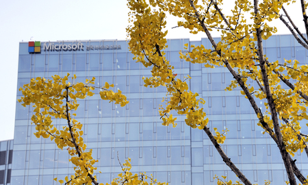 microsoft: Seoul, South Korea-November 11, 2015: Microsoft Head Office in South Korea and at the foreground some yellow leafs. Selective focus at leafs.November 11, 2015 Seoul, South Korea
