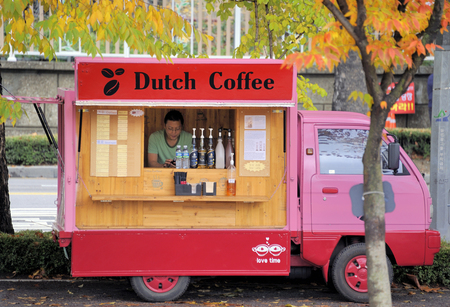 selling service: Seoul,South Korea-November 9, 2015:Sales truck for Dutch Coffee in a park in midtown Seoul.November 9, 2015 Seoul, South Korea