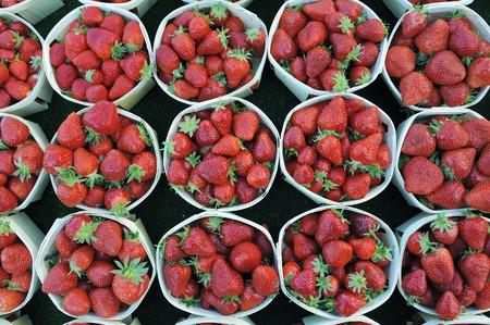 greengrocer: Strawberries at a greengrocer at a market in France