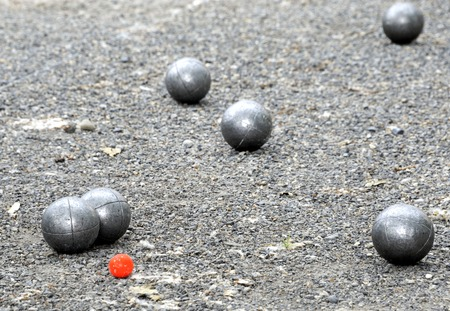 french boule: Playing jeu de boules or also called petanque in France. This play is played at street in every village of France.