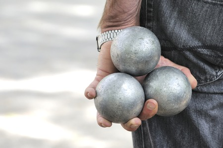 boules: Playing jeu de boules or also called petanque in France. This play is played at street in every village of France.