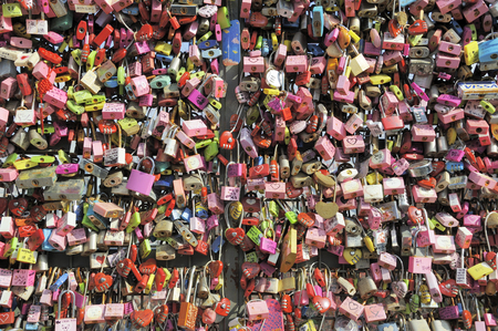 symbolize: Seoul, South Korea - November 12, 2015: Thousands of love padlocks at Namsan Seoul Tower. Locks of love is a custom in some cultures which symbolize their love will be locked forever. November 12, 2015 Seoul South Korea