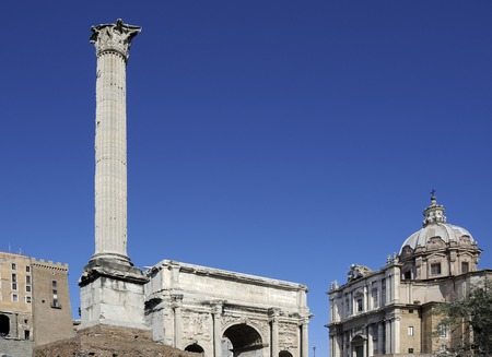 severus: The Column of Phocas, Forum Romanum, Rome, Italy. On the right, Arch of Septimius Severus and the facade of the Church of Saint Luke and Martina.
