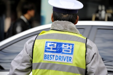traffic cop: Seoul, South Korea- Traffic cop seen from the back. Stock Photo