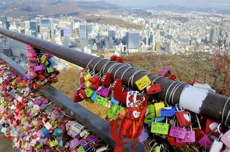 Seoul, South Korea - November 12, 2015: Thousands of love padlocks at Namsan Seoul Tower. Locks of love is a custom in some cultures which symbolize their love will be locked forever. November 12, 2015 Seoul South Korea