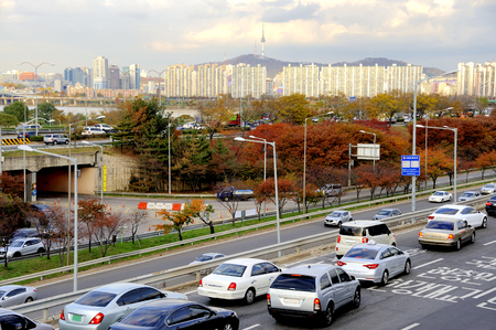 12 hour: Seoul, South Korea-November 12, 2015; Traffic on a highway leading to the city center. During rush hour all highways and main roads are full with traffic. At the background the Seoul Tower.November 12, 2015 Seoul,South Korea Editorial