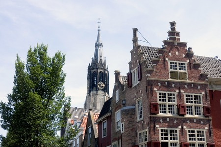 Church and houses in Delft with typical Dutch gables