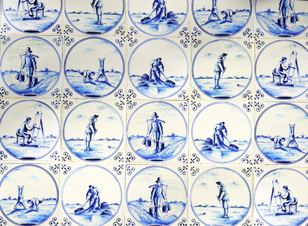 Close up of antique tin glazed blue Delft wall tiles dating from about 1650