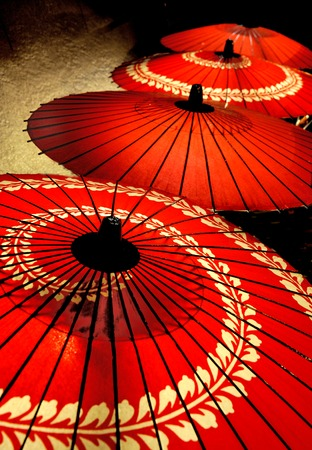 Beautiful red parasols by night in Japan