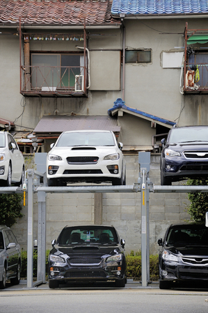 KYOTO,JAPAN-NOVEMBER 5, 2014: Japanese style Multilevel Car Parking System to use as much parking space as possible