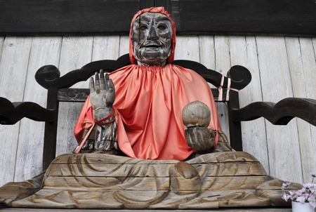 NARA, JAPAN-NOVEMBER 06,2014: The Great Buddha Hall (Daibutsuden), Todai-ji temple. Wooden statue of Binzuru (Pindola), who was one of the sixteenth arahats, who were disciples of Buddha.Situated