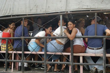 HAVANA, CUBA-MAY 05, 2016: Group of unidentified people in a open truck. In 2004, the public transportation system is non-existent in Cuba, helping the locals to travel across the country.