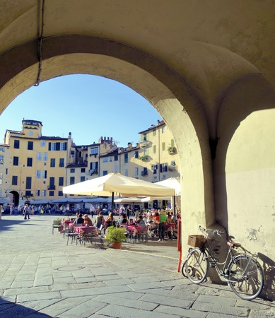 Piazza dellAnfiteatro from the city of Lucca, Italy seen from one of the entrance gates