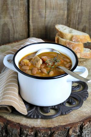 Bean soup with ham and chorizo photo