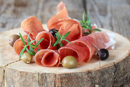Prosciutto with olives and rosemary photo