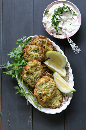 fritter: Zucchini fritters with yogurt dressing and parsley