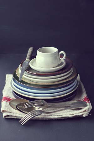 Stil: Still life with vintage plates and spoons-vintage effect added Stock Photo