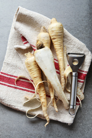 parsnips: Parsnips on kitchen cloth.Top view.