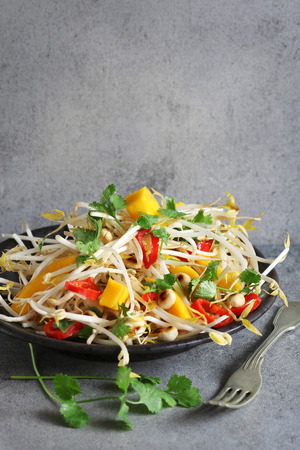 red chilli: Alfalfa sprouts salad with mango,red chilli,toasted almonds and coriander Stock Photo