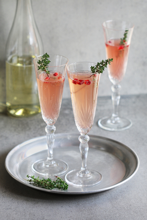 pomegranate juice: Pomegranate champagne in glasses with fresh thyme decoration