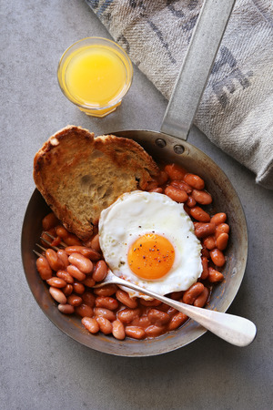 beans on toast: English breakfast with fried egg, beans and toast