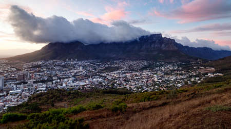 Sunrise over a cloudy Table Mountain in Cape Town, South Africa. Stock Photo