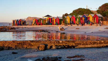 St James beach is well known for its colorful Victorian-style bathing boxes, tidal pool and rock pools. Cape Town, South Africa, 22 May 2021.