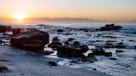 Sunrise as viewed from St James Beach, St James, Cape Town, South Africa.