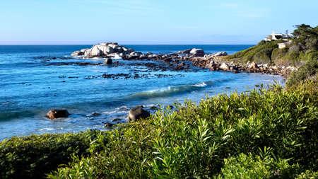 Scenic view of a rocky beach on the False Bay coastline. Cape Peninsula, South Africa. Stock Photo