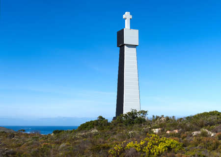 The commemorative Dias Cross Navigational Beacon navigation beacon stands in the Cape of Good Hope reserve close to Cape Point, South Africa.