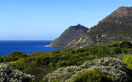 View of False Bay and Cape Point with Matrooskop in the foreground. Cape Town, South Africa. Stock Photo