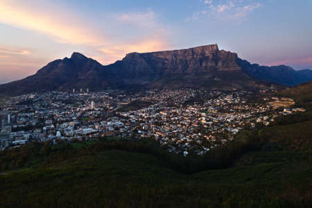 The winter sun rises over Cape Town and Table Mountain in South Africa.