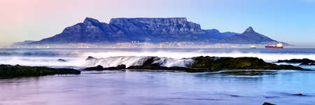 Twilight panoramic of Table Mountain in Cape Town as viewed from Bloubergstrand, South Africa.