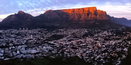 Sunrise aerial, drone panoramic of the city of Cape Town with Table Mountain, South Africa in the background.