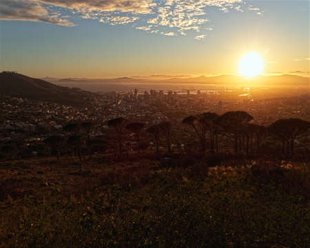 Winter sunrise over Cape Town in South Africa as viewed from the slopes of Table Mountain.