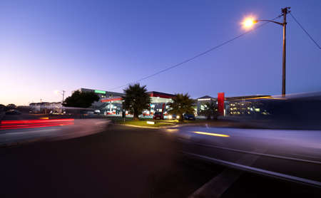 Long exposure, twilight image of the morning traffic at a service station / gas station.