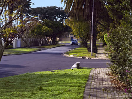 Streetscape of the pleasant tree lined streets of a Garden City suburb.