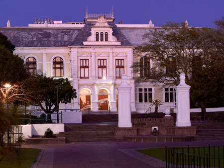 Twilight view of the Iziko South African Museum, a South African national museum  situated in the historic Company's Gardens in Cape Town. 25 July 2021.