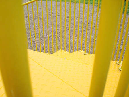 jungle gym: Yellow stairs on a jungle gym at the playground park on a sunny day.