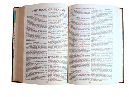 The Holy Bible opened to the Book of Psalms on a white background.