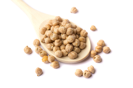 Grain chickpeas in a wooden spoon isolated