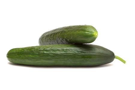 unsliced: Two of cucumber isolated on white background