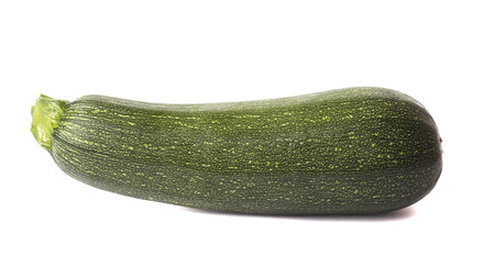 isolated on green: Large green zucchini isolated on white background