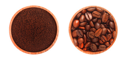 Two wooden plates with ground coffee and coffee beans, isolated on white background.