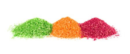 Heap of shredded coconut on white background. Dried grated coconut. Multicolored dyed shredded coconut. Banco de Imagens