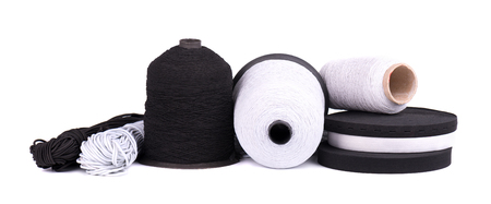 Black and white sewing elastic band isolated on white background. A variety of elastic bands for clothing and furniture Фото со стока