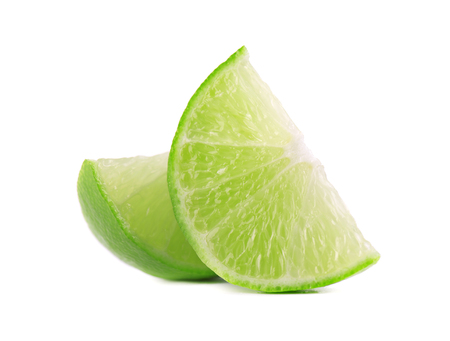 Ripe slice of green lime citrus fruit, isolated on white background. Lime wedge with clipping path.