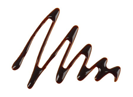 Chocolate syrup drop isolated on white background. Top view Stock Photo