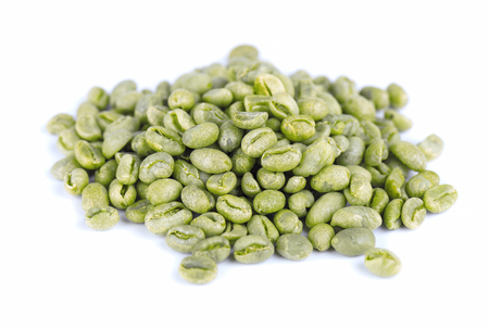 Green coffee beans background. Medium green peaberry coffee beans